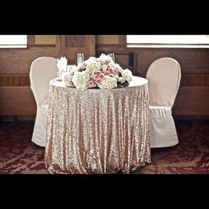 "Accessories - 120"" round champagne sequin tablecloth ($60)"